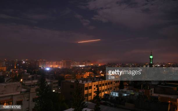 Picture taken early on January 21, 2019 shows Syrian air defence batteries responding to what the Syrian state media said were Israeli missiles...