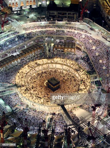A picture taken early on July 16 2015 from the Abraj alBait Towers also known as the Mecca Royal Hotel Clock Tower shows Muslim worshipers praying at...