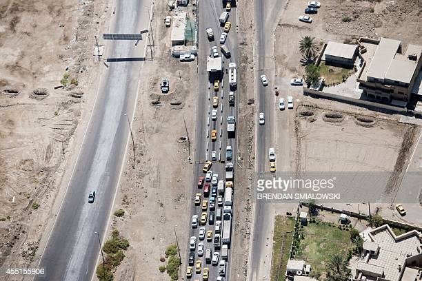 A picture taken from a helicopter on September 10 2014 shows a congested road in Baghdad as US Sectary of State arrives in the Iraqi capital Kerry is...