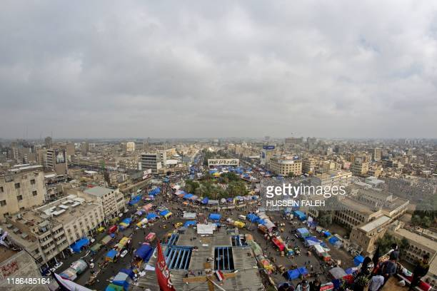 A picture taken from a rooftop on December 3 shows a general view of Tahrir square in the center of the Iraqi capital Baghdad where most of the...