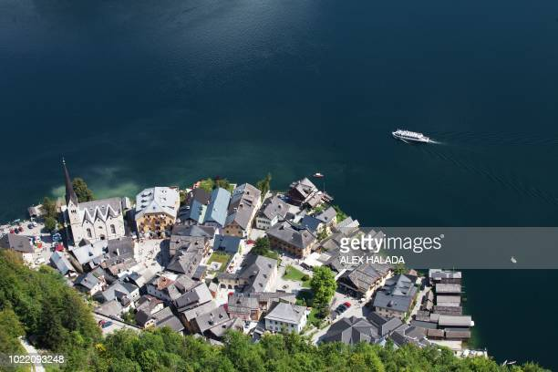 A picture taken from a suspended platform above the Hallstatt Lake shows an overview of Hallstatt at the world heritage saltmine in Hallstatt Austria...