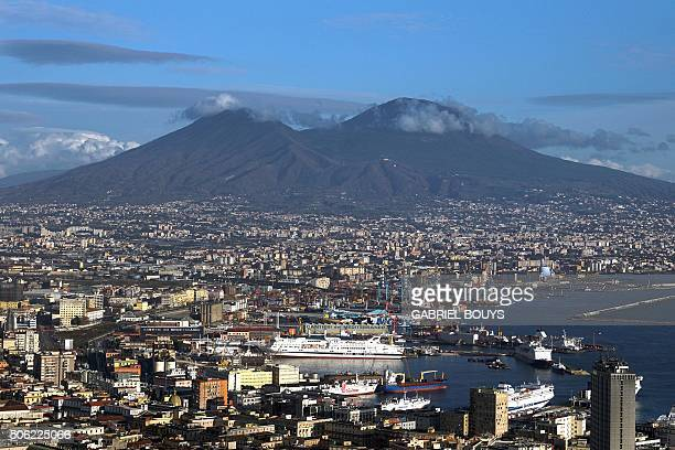 A picture taken from a terrace shows Naples' bay and the Vesuvius volcano on January 9 2016 in Naples AFP PHOTO / GABRIEL BOUYS / AFP / GABRIEL BOUYS