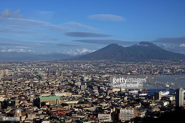 A picture taken from a terrace shows the city of Naples and the Vesuvius volcano on January 9 2016 in Naples AFP PHOTO / GABRIEL BOUYS / AFP /...