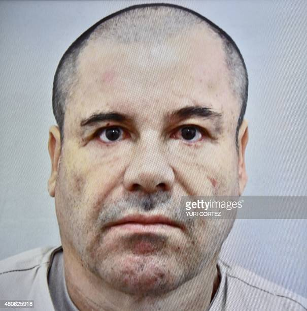 Picture taken from a tv screen of Mexican drug kingpin Joaquin 'El Chapo' Guzman displayed during a press conference held at the Secretaria de...