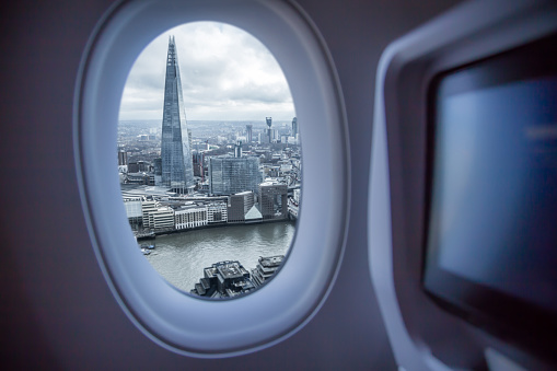 Picture taken from airplane window traveling around the world from the airplane with London view. - gettyimageskorea