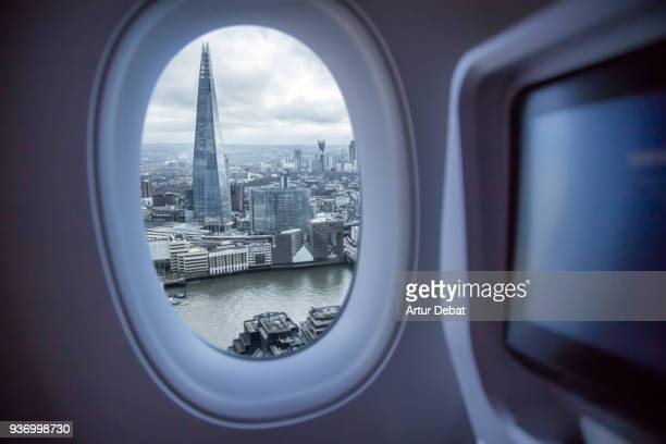Picture taken from airplane window traveling around the world from the airplane with London view.