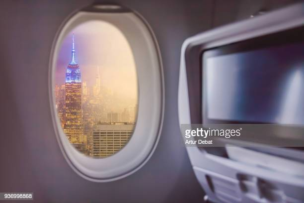 Picture taken from airplane window traveling around the world from the airplane with Manhattan skyline view.