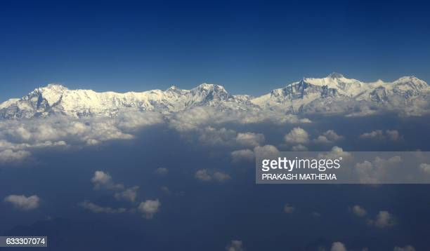 A picture taken from an aircraft shows an aerial view of the Himalayan Mountain range of Annapurna and Mount Machapuchare west of Kathmandu on...