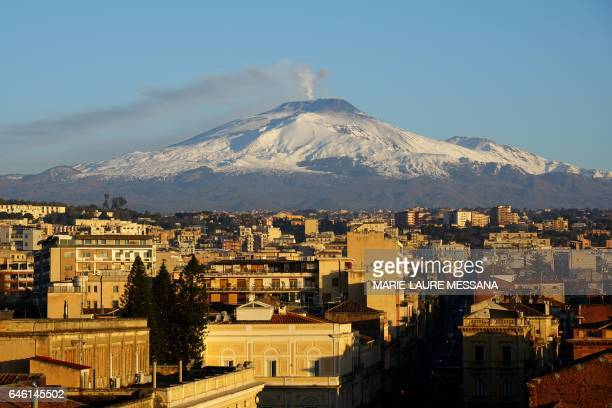 A picture taken from Catania Sicily shows the Etna volcano covered with snow on February 16 2017 / AFP / MarieLaure MESSANA