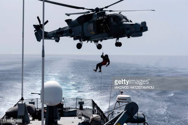 A picture taken from Cyprus' warship Ioannides shows a Royal Navy Lynx helicopter taking part in the Multinational CIMIC Exercise ARGONAUT 2019...