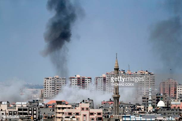 TOPSHOT A picture taken from Gaza City on May 29 shows a smoke billowing in the background following an Israeli air strike on the Palestinian enclave...
