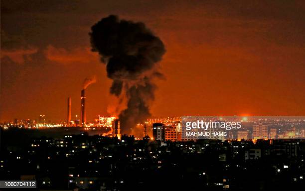 TOPSHOT A picture taken from Gaza City on November 12 shows smoke billowing in the distance during Israeli air strikes on the Hamasrun Palestinian...