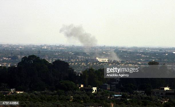 Picture taken from Gaza part of Rafah shows smke rising as Egyptian troops and militants in Rafah in North Sinai and Egypt's eastern border with the...