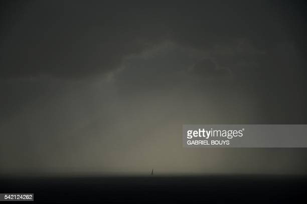 A picture taken from Ginostra shows a boat sailing on June 19 2016 off the Stromboli island Stromboli is part of the Aeolian Islands a volcanic...