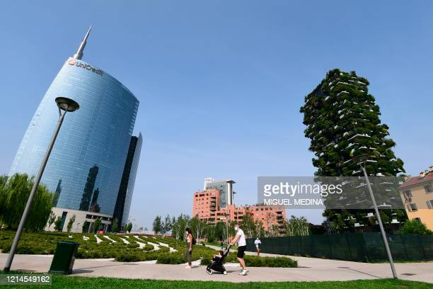 """Picture taken from Milan's botanical park """"Library of Trees"""" in the Porta Nuova district on May 22, 2020 shows the Unicredit tower and the Vertical..."""
