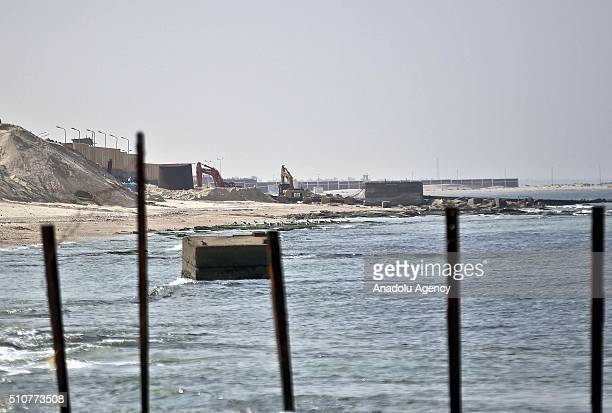 Picture taken from Rafah, Gaza on February 17, 2016 shows that construction vehicles are seen on duty at a pier construction site in Taba, Egypt. The...