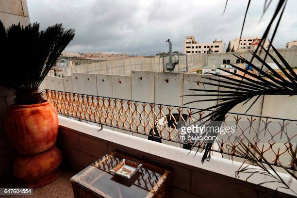 A picture taken from the balcony of one of the rooms at street artist Banksy's newly opened Walled Off hotel in the Israeli occupied West Bank town...