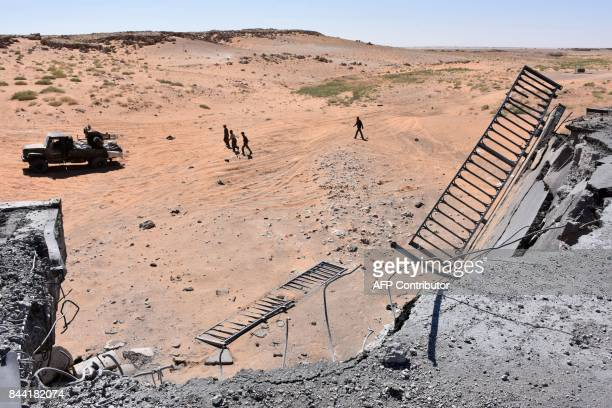 A picture taken from the destroyed bridge on a road between the Kabajeb and AlShula on the southwestern outskirts of Deir Ezzor on September 8 shows...