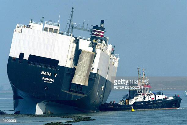 Picture taken from the Dutch coast near Bath showing the 186 meter long Panamanian Nada V ship and a tugboat at work after the cargo ship collided...