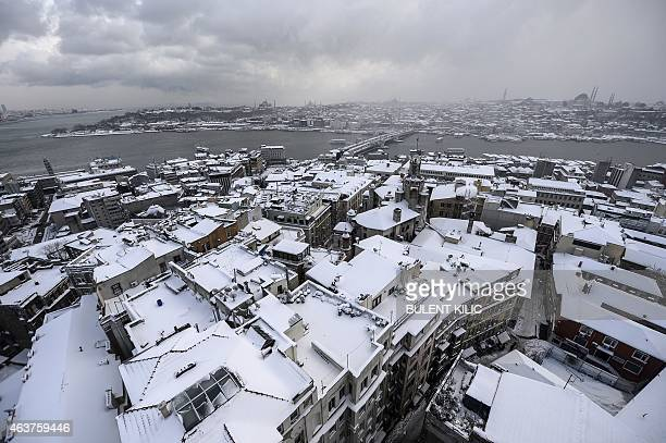 A picture taken from the Galata tower shows roofs covered with snow in Istanbul on February 18 2015 Istanbulites woke up to find the famed minarets...