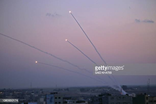 TOPSHOT A picture taken from the Gaza Strip on November 12 2018 shows missiles being launched toward Israel A number of rockets were launched from...