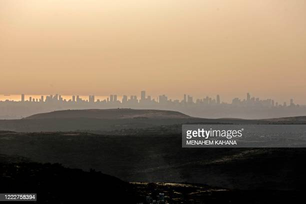 Picture taken from the Israeli settlement of Naale in the occupied West Bank northwest of the Palestinian city of Ramallah shows the skyline of the...