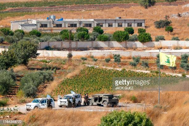 A picture taken from the Israeli side of the border with Lebanon on August 27 2019 shows Lebanese army and United Nations Interim Forces in Lebanon...