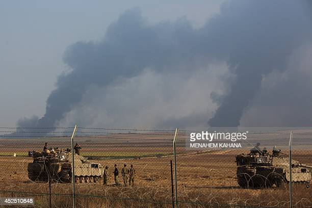 A Picture taken from the Israeli side of the border with the Gaza Strip shows smoke billowing from the coastal Palestinian enclave following an...