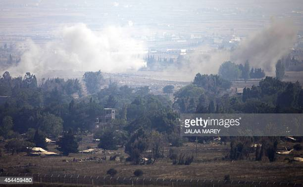 A picture taken from the Israeliannexed Golan Heights shows smoke billowing from the Syrian village of Quneitra following an explosion during...