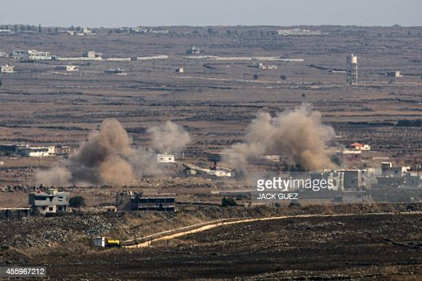 A picture taken from the Israeliannexed Golan Heights shows smoke billowing from the Syrian village of Khan Arnabeh near the eastern border crossing...