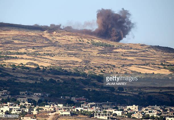 A picture taken from the Israeliannexed Golan Heights shows smoke rising in the Syrian Druze village of Hadar on June 20 following Syrian army...