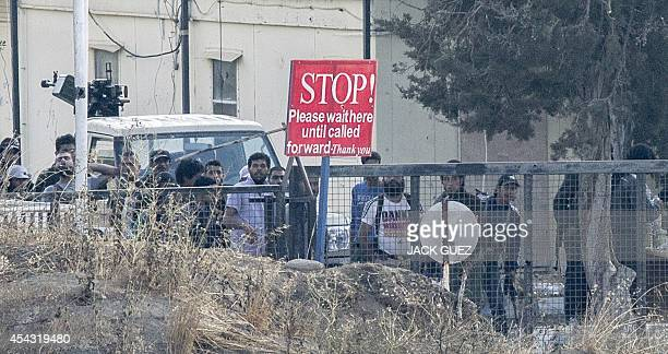 A picture taken from the Israelioccupied Golan Heights shows armed men reportedly rebel fighters standing in the Syrian side of the Golan at the...