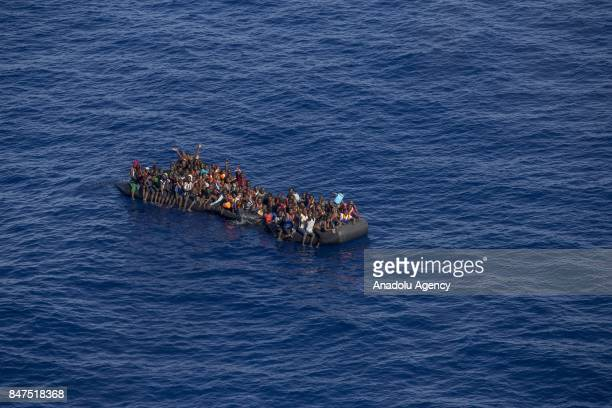 A picture taken from the moonbird aircraft of the German NGO SeaWatch shows that hundreds of migrants are rescued with a rubber dinghy in the...
