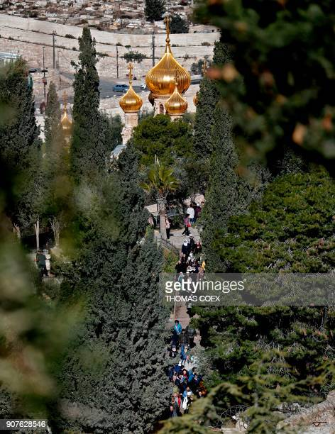 A picture taken from the Mount of Olives on January 20 shows Christian pilgrims walking out of the Church of Mary Magdalene a Russian Orthodox church...