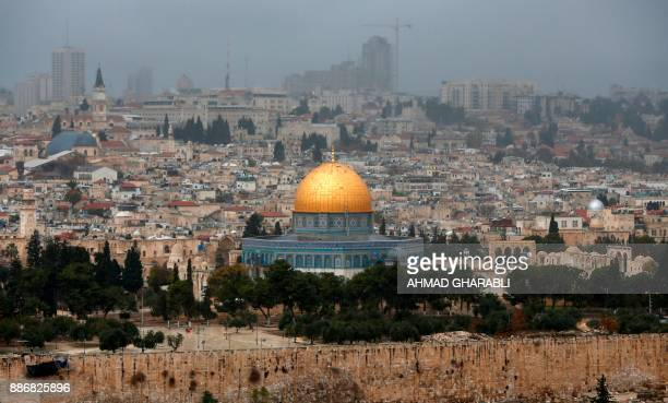A picture taken from the Mount of Olives shows the Old City of Jerusalem with the Dome of the Rock mosque in the centre on December 6 2017 President...