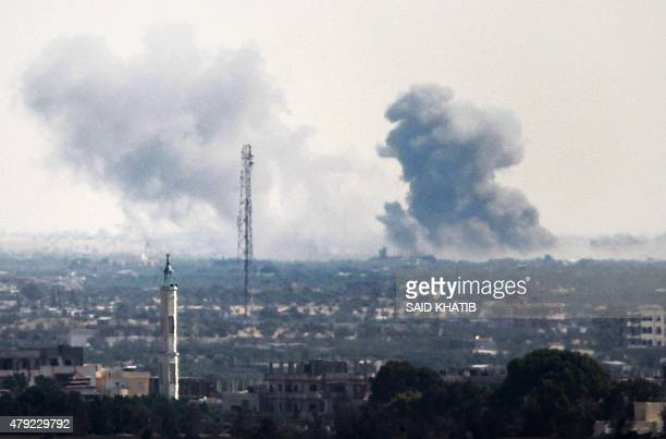 A picture taken from the Rafah border of the southern Gaza Strip with Egypt shows smoke billowing in Egypt's North Sinai on July 2 2015 At least 70...