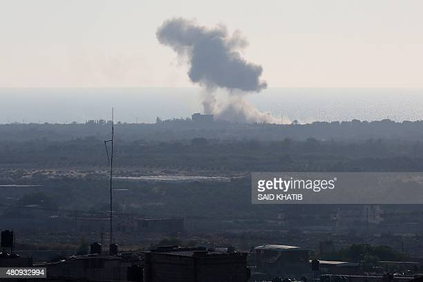 A picture taken from the Rafah border of the southern Gaza Strip with Egypt shows smoke billowing in Egypt's North Sinai on July 16 2015 Earlier...