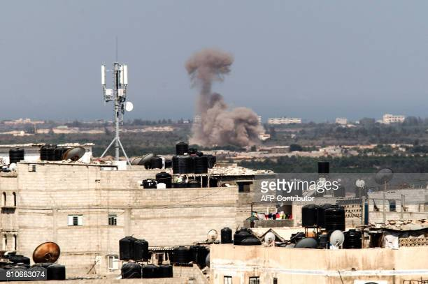 A picture taken from the Rafah border of the southern Gaza Strip with Egypt shows smoke billowing in Egypt's North Sinai on July 8 2017 Twentysix...