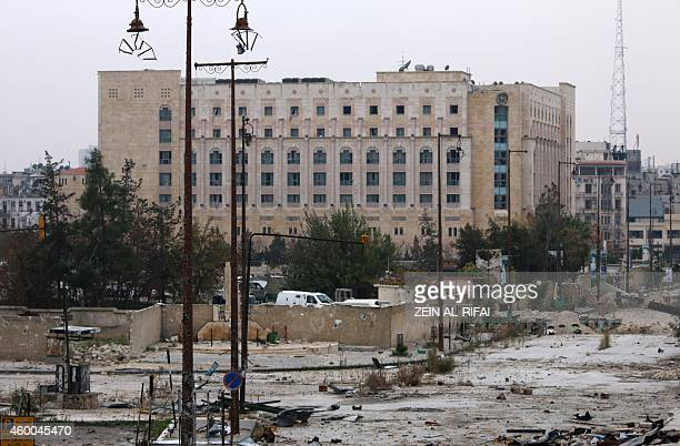 A picture taken from the rebelheld side in the old city of Aleppo shows the Sheraton hotel currently under government control in the governmentheld...
