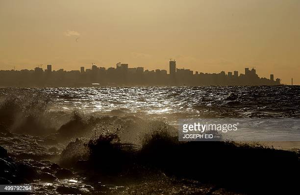 A picture taken from the shores of the town of Dbayeh north of Beirut shows the skyline of the Lebanese capital covered in smog on December 3 2015 /...