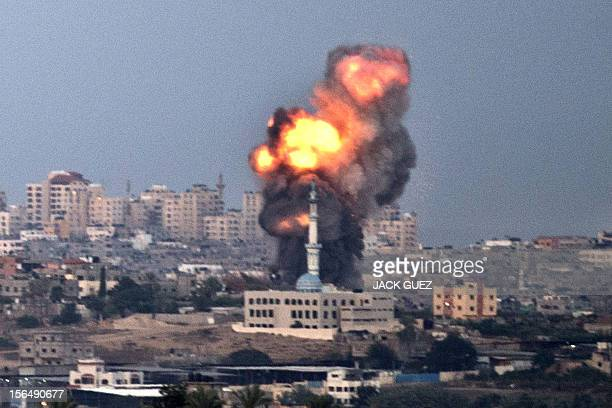A picture taken from the southern Israeli border with Gaza shows smoke billowing from a spot targeted by an Israeli air strike inside the Gaza strip...