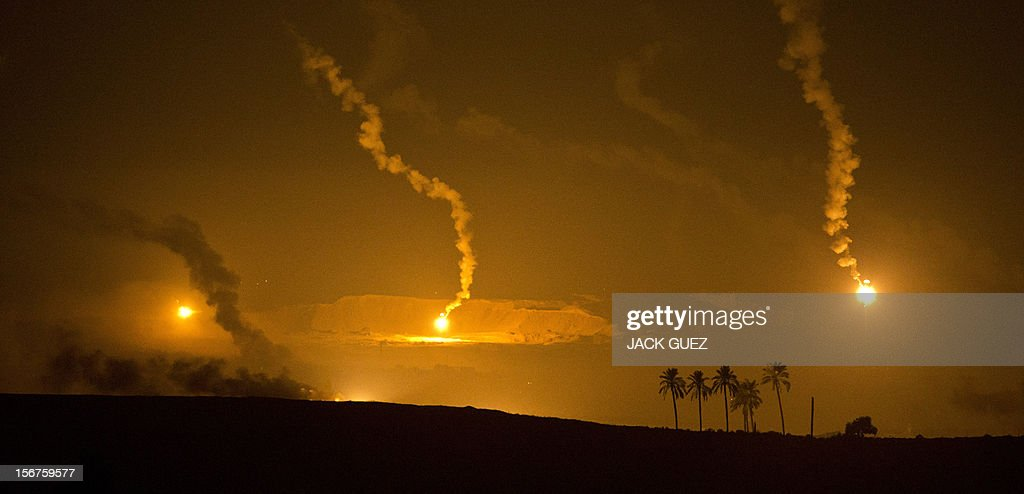 A picture taken from the southern Israeli border with the Gaza Strip shows Israeli artillery flares illuminating the Palestinian coastal enclave on November 20, 2012. Gaza militants said a Cairo-brokered truce in their seven-day war with Israel would be announced, as Israeli Prime Minister Benjamin Netanyahu urged them to choose between 'the sword' and peace. According to health officials in Gaza, a total of more than 125 Palestinians have been killed and over 1,000 wounded since Israel began its relentless military campaign on November 14 in a bid to stamp out cross-border rocket fire by militants.