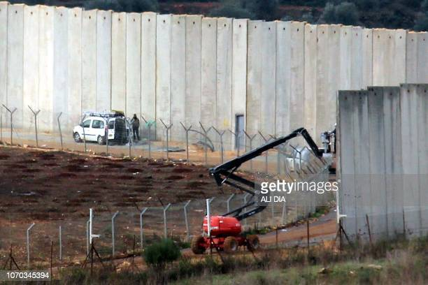 A picture taken from the southern Lebanese village of Kfar Kila near the border with Israel on December 9 shows Israeli machinery operating next to...
