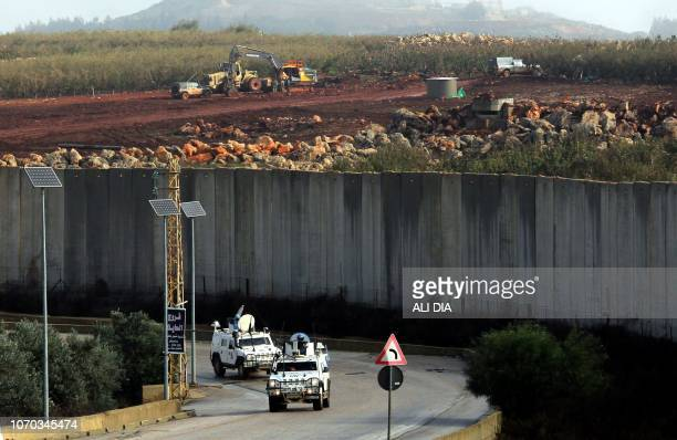 TOPSHOT A picture taken from the southern Lebanese village of Kfar Kila on December 9 near the border with Israel shows United Nations Interim Forces...
