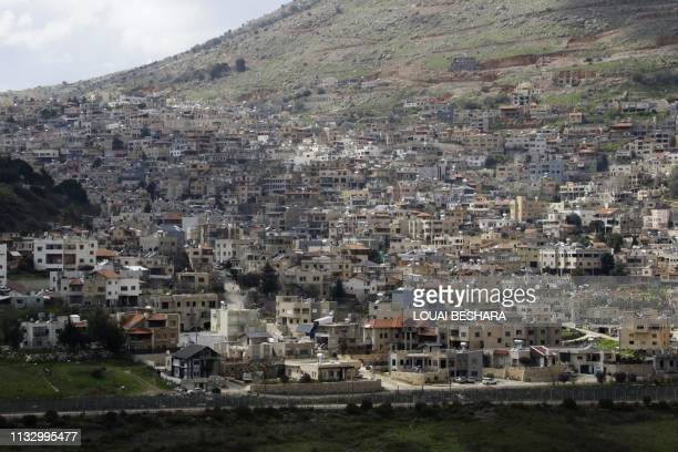 Picture taken from the Syrian town Ain al-Tineh shows the Druze town of Majdal Shams in the Israeli- annexed Golan Heights on March 26, 2019. - US...