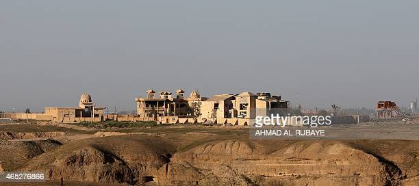 Picture taken from the village of Awja on the outskirts of the city of Tikrit on March 5 shows the palace of Iraq's former leader Saddam Hussein in...