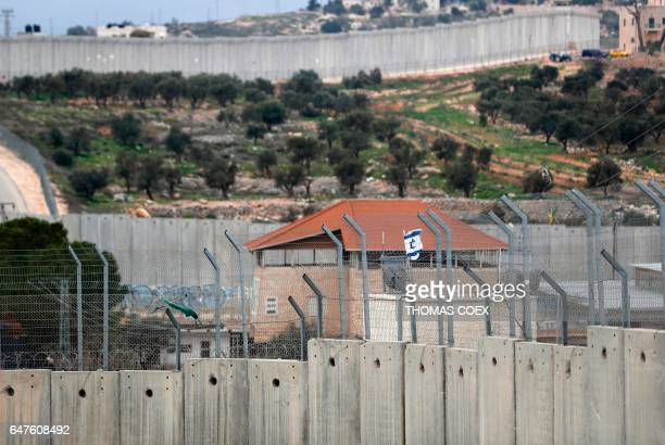 A picture taken from the window of one of the rooms at street artist Banksy's newly opened Walled Off hotel in the Israeli occupied West Bank town of...