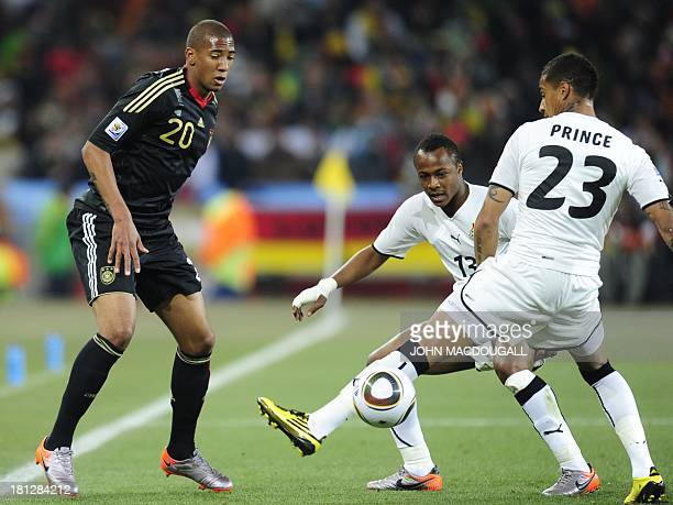 Picture taken Ghana on June 23 2010 shows Germany's defender Jerome Boateng fights for the ball with his brother Ghana's striker KevinPrince Boateng...