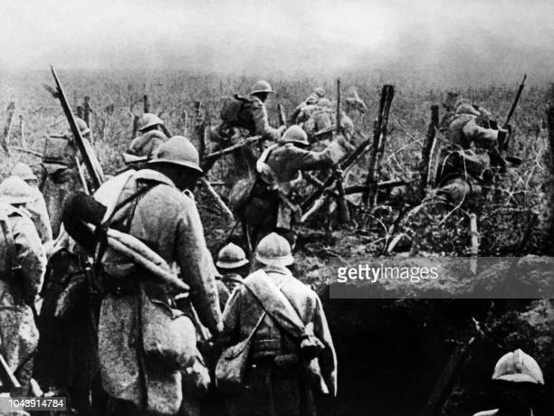 Picture taken in 1916 of French soldiers moving into attack from their trench during the Verdun battle eastern France during the first World War The...