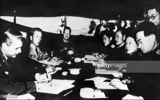 Picture taken in 1951 at Pan Mun Jom of Communists and US liaison officers discussing an armistice. United States and China supported respectively...